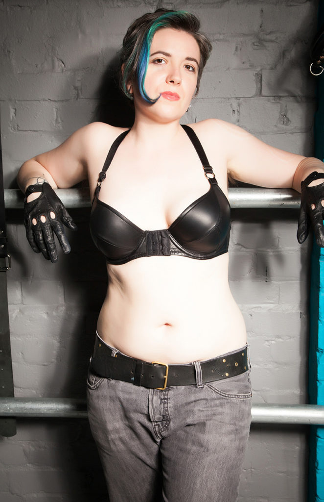 London Leather Mistress in gloves and a leather bra