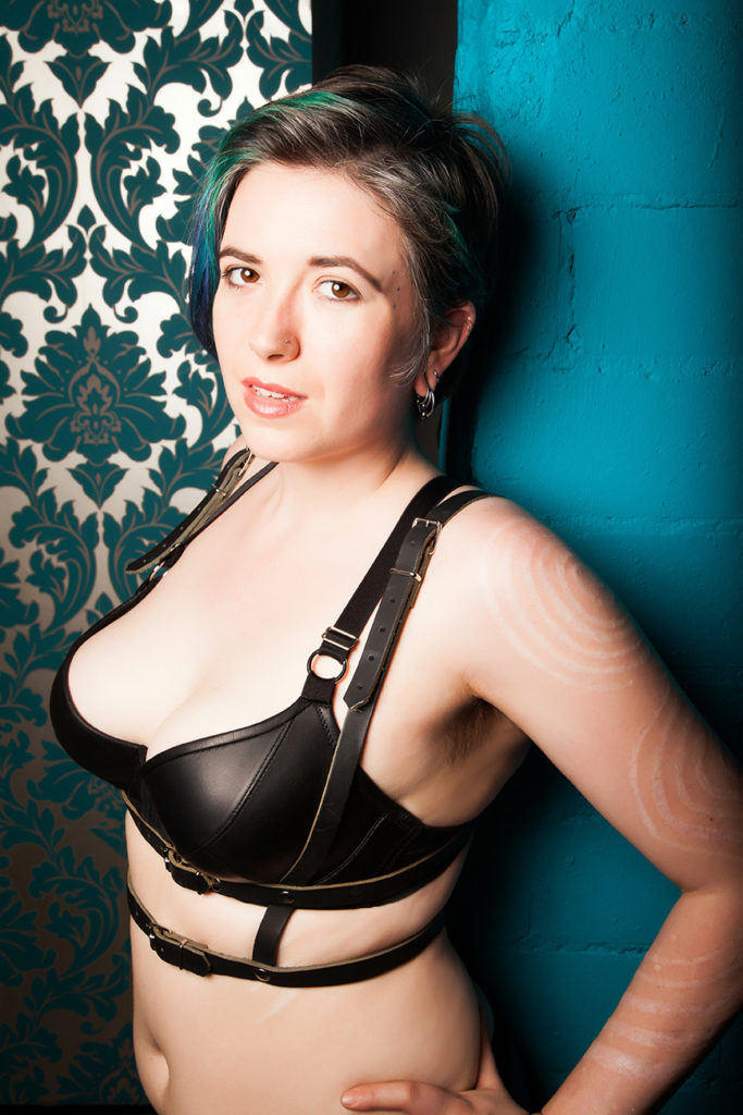 London Mistress in leather harness and leather bra