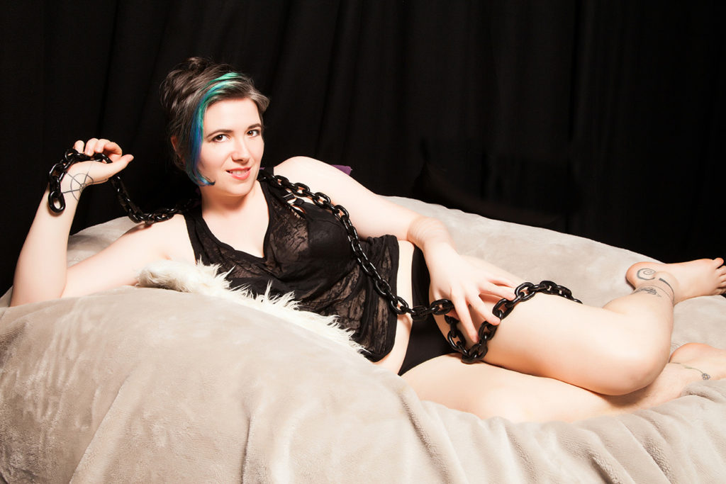 Casual London Dominatrix relaxing in panties and heavy chain