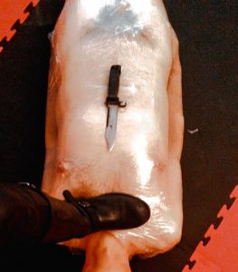 Cling film wrapped mummified slave